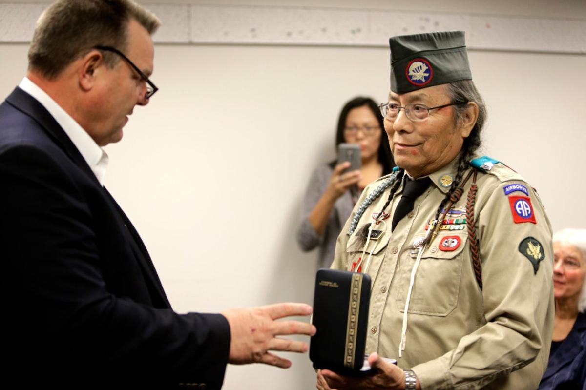 U.S. Sen. Jon Tester presents a Bronze Star