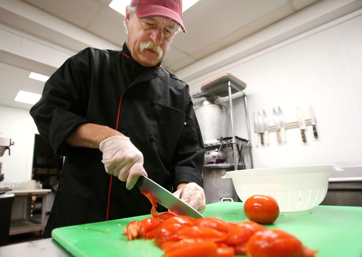 Scott Wooden chops tomatoes
