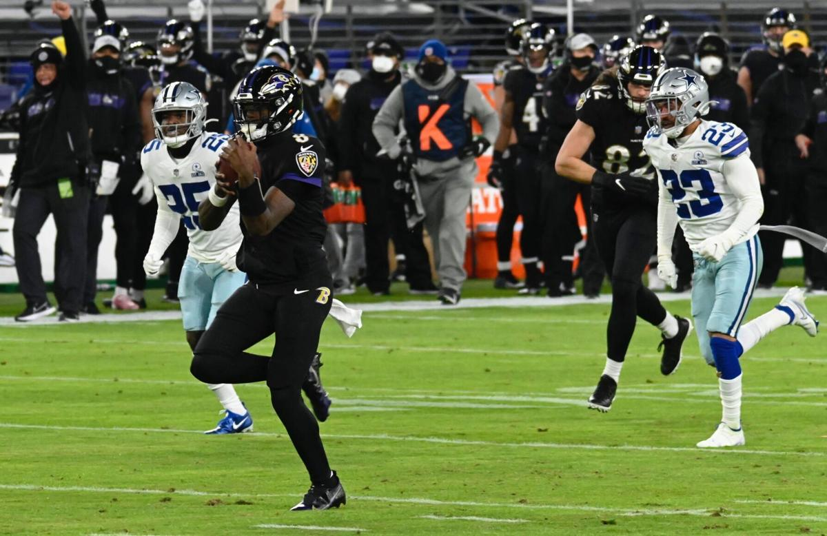 Cowboys' #25, Xavier Woods, and #23, Darian Thompson, try to catch him while Ravens' #82, Luke Willson, defend the play.