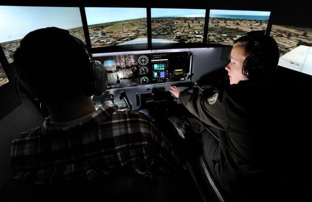 Aviation students Derek Shattenberger, left, and instructor Tyle