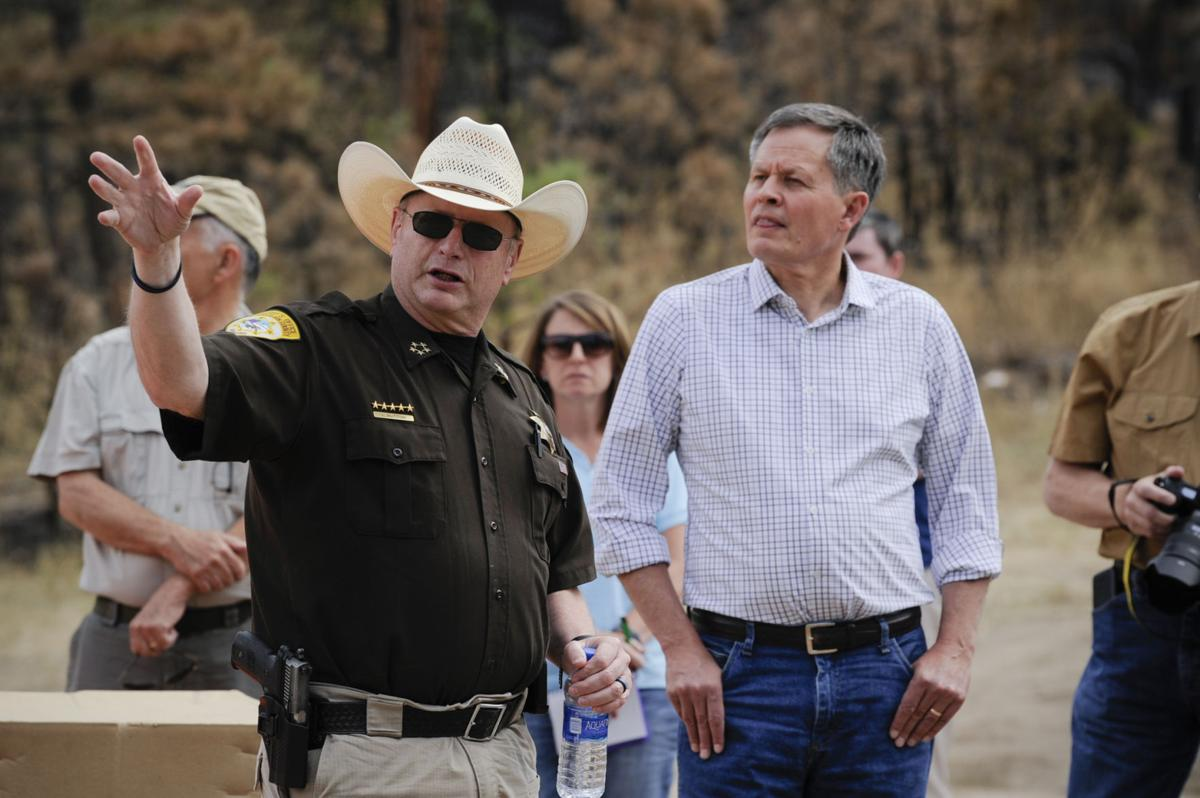 Lewis and Clark County Sheriff Leo Dutton, left,