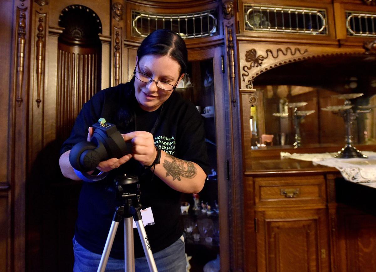 Robbie Blakely sets up a dining room camera