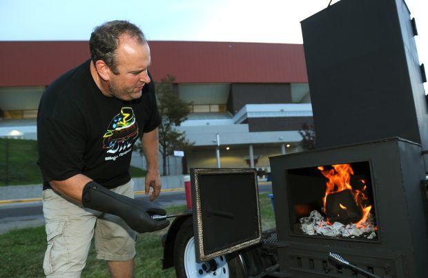 Brad Halsten checks the fire box
