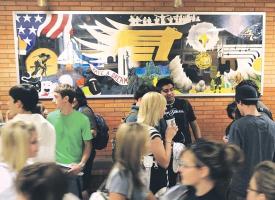 On the wall: West panels reflect school, world beyond