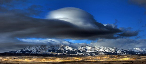 A lenticular cloud formed as high winds blew over the Crazy Moun