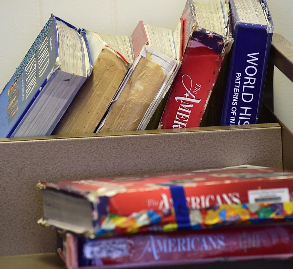 Tattered Billings textbooks