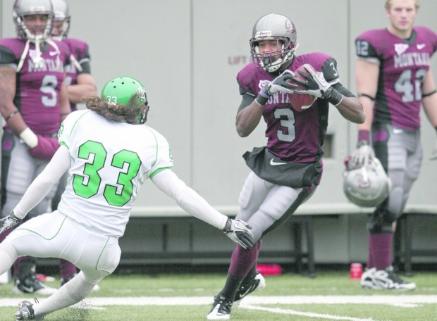 Montana wide receiver Antwon Moutra (3) catches a pass in front of North Dakota free safety Erik Mersereau (33)