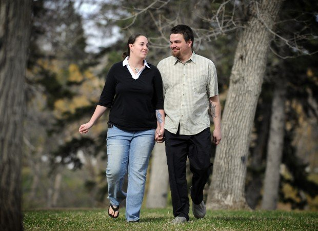Michael Daem and his fiancée, Amber Noble, walk through Pioneer Park