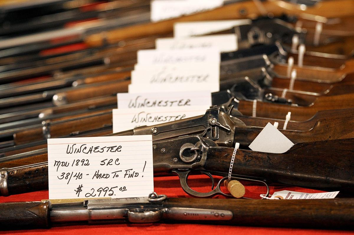 Winchester rifles at a gun show