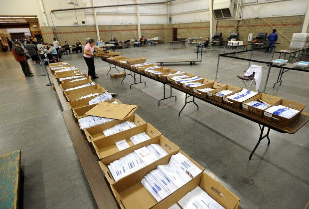 Absentee ballots are sorted