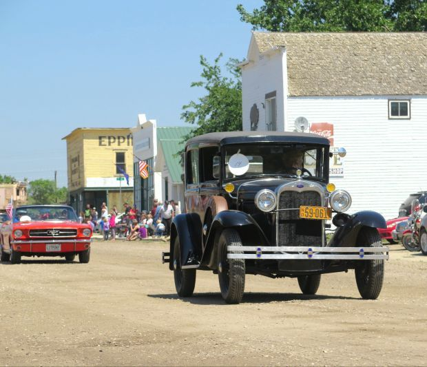 Vintage cars drive down Epping's Main Street