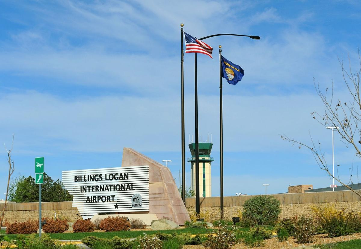 Billings airport entrance sign and flags
