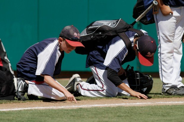 Billings players write their names into the field