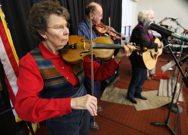 Gladys Burns plays the fiddle