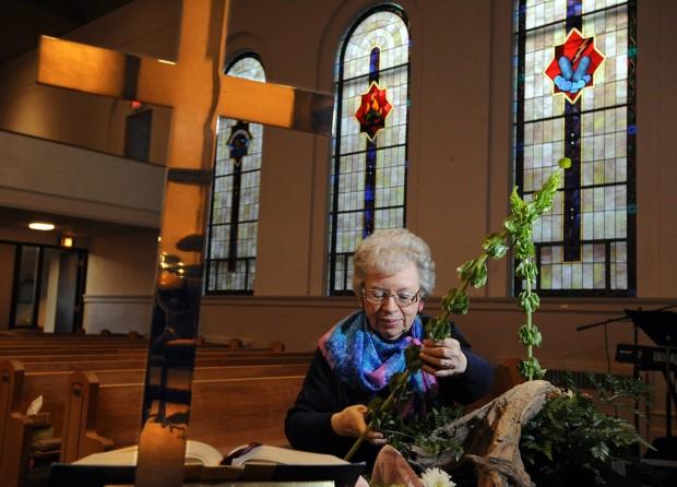 Shirley Spildie arranges flowers at First Baptist Church