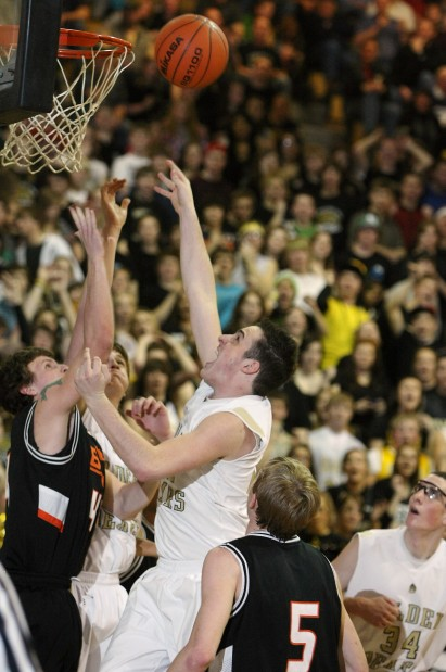 Jacob Betcher of Billings West tips in a ball