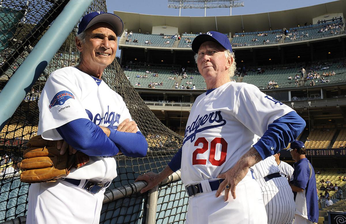 Former Dodger pitchers Sandy Koufax, left, and Don Sutton chat before an old-timers game at Dodger Stadium on Saturday, June 8, 2013. in Los Angeles.