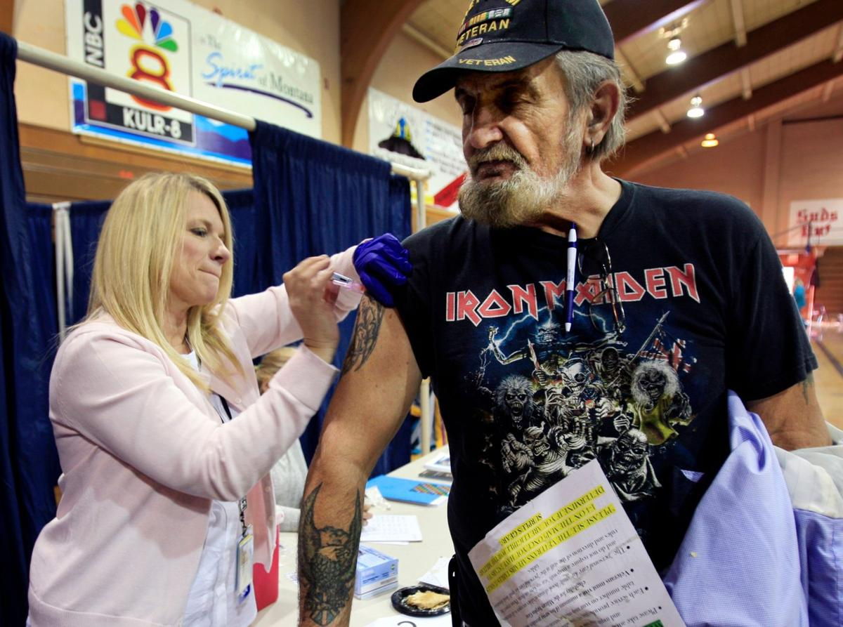Keith Russell receives a flu shot