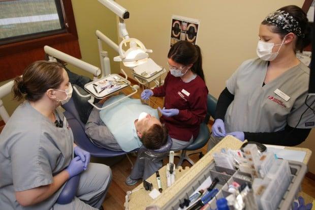 Dental assistants at work