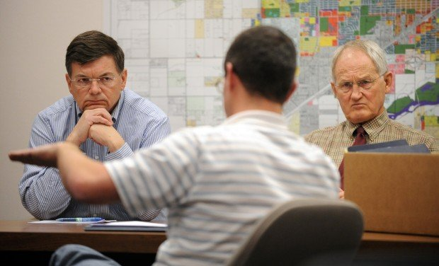 Bill Kennedy, left, and Jim Reno listen as Yellowstone County El