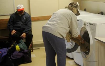 A couple finishes laundry