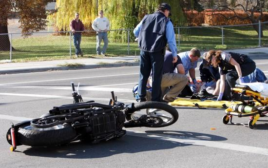 Two people hospitalized in separate motorcycle accidents today