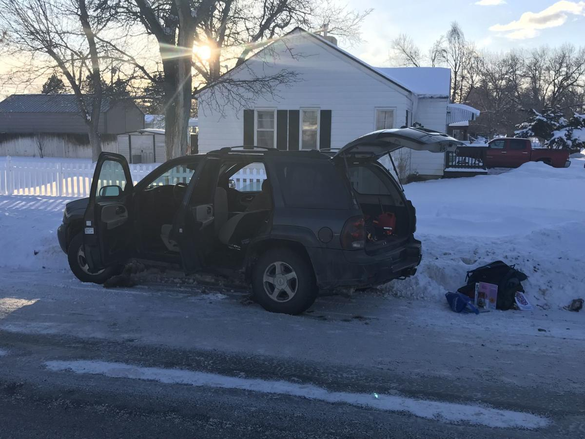 Man arrested after fleeing traffic stop, crashing SUV into snowbank