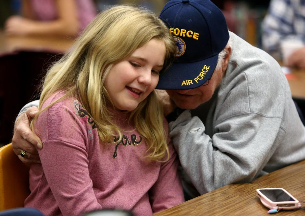 U.S. Air Force veteran James VonSchriltz hugs his granddaughter Jaelee Von Schriltz