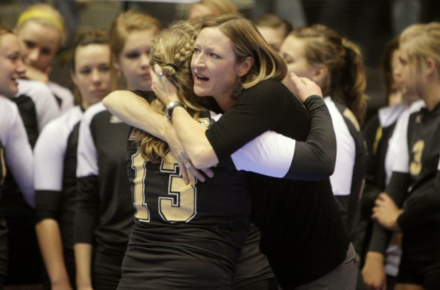 Billings West volleyball coach Beth Tocci hugs Liz King after Bozeman defeated West