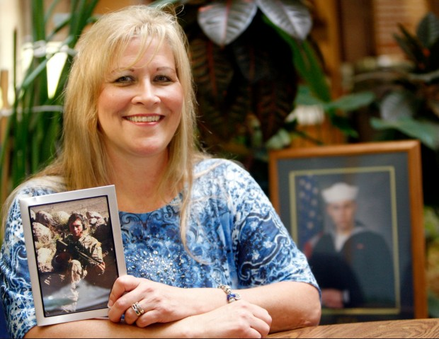 Crystal Reichenbach holds a photo of her son