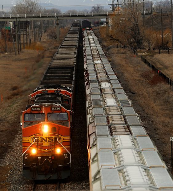 Grain and coal trains pass one another