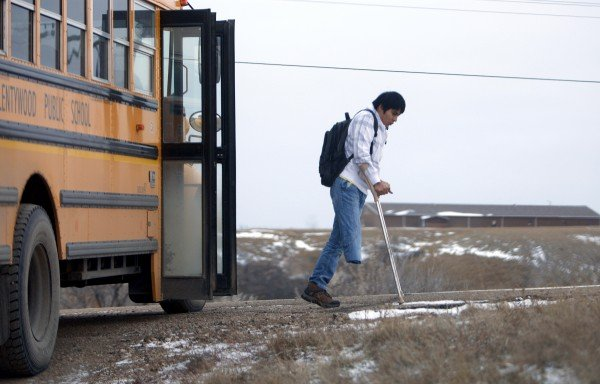 Firdavs Temirov gets off the school bus