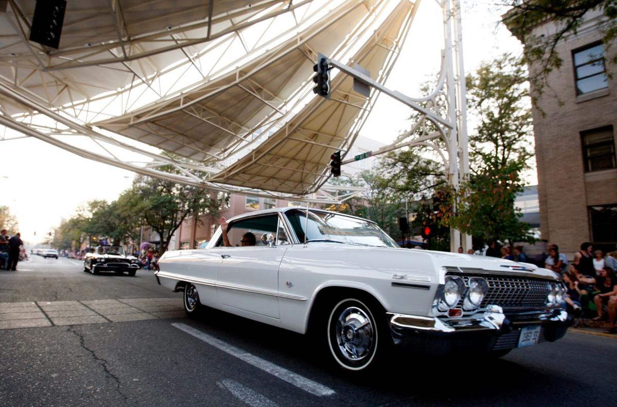 cars of all kinds roll through downtown billings for burn the
