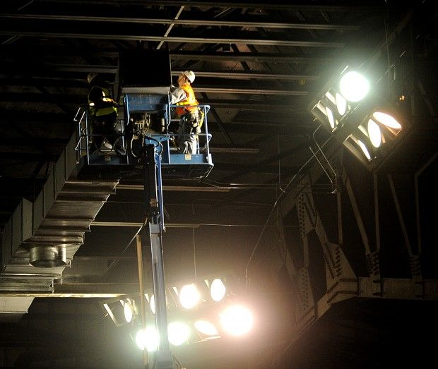 Workers install ductwork