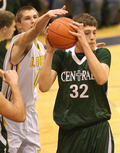 Laurel's Zach Allen, 0, and Central's Daniel Meyer, 32, battle for the ball