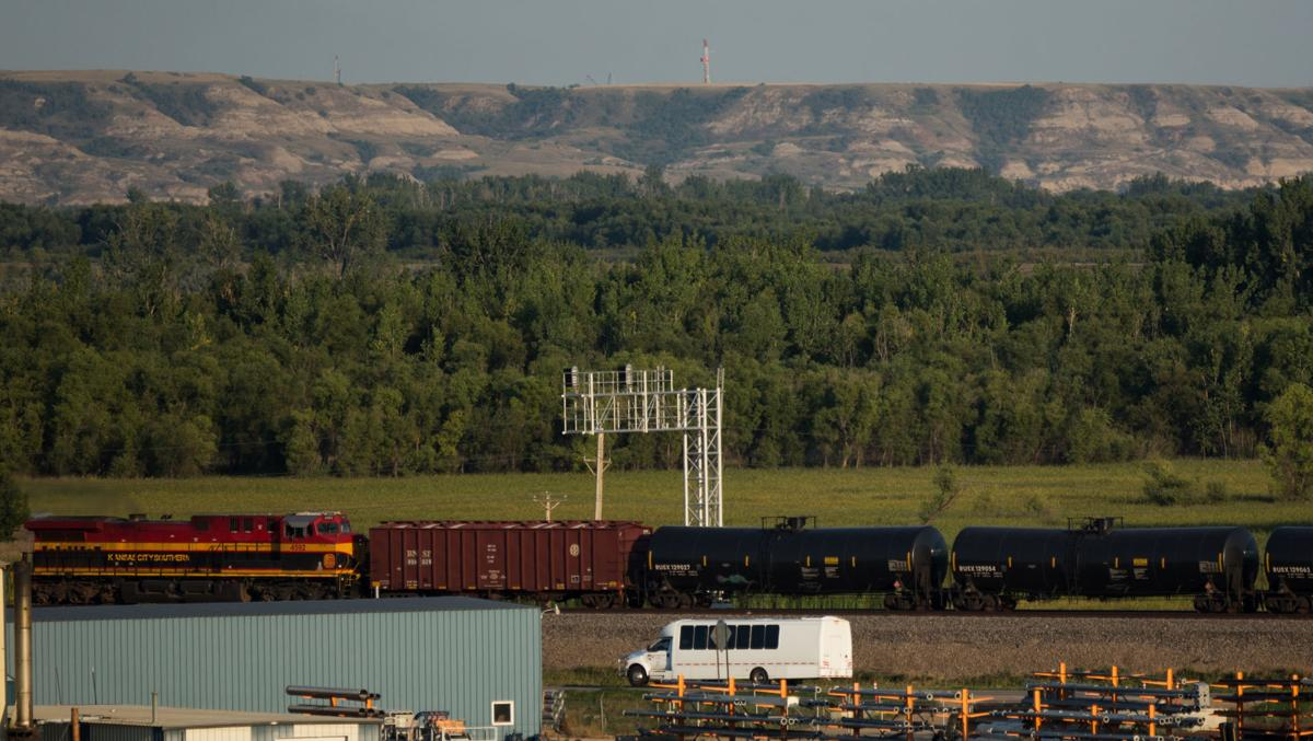A train takes oil by rail out of Williston