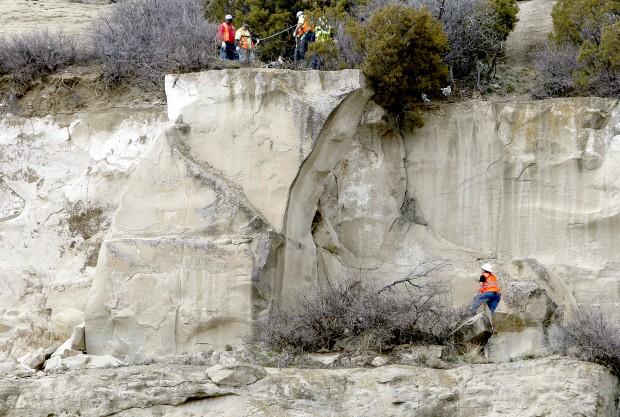 Vern Balkowitsch looks at a slab of sandstone