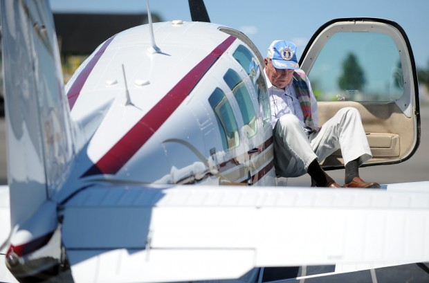 WWII veteran Kenny Kjelstrup from Kalispell climbs out of Angle
