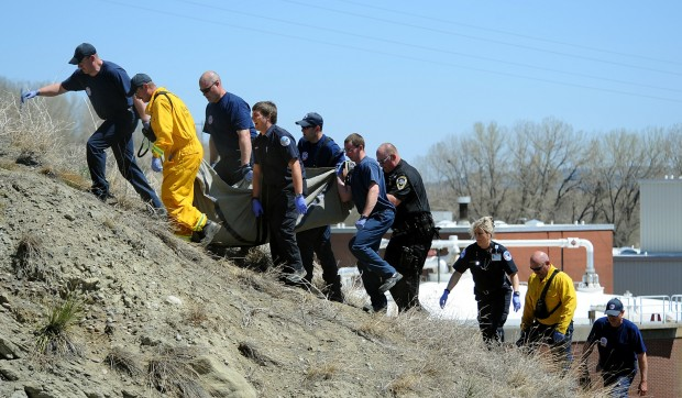 Crews move body up hill
