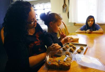 Myeshea McKinney makes cookies with her granddaughter Aaliyah Wilson