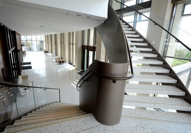A staircase connects the fourth and fifth floors
