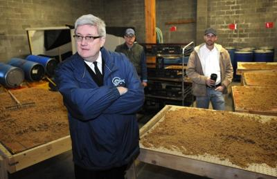 Salvation Army Maj. Kevin Jackson, foreground, shows a composting operation