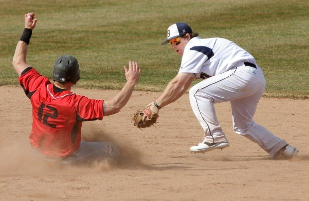 MSUB's Brody Miller, 7, tags out  NW Nazarene's Jamie Mitchell