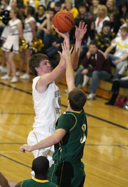 Brady Gustafson of Billings West attempts a shot