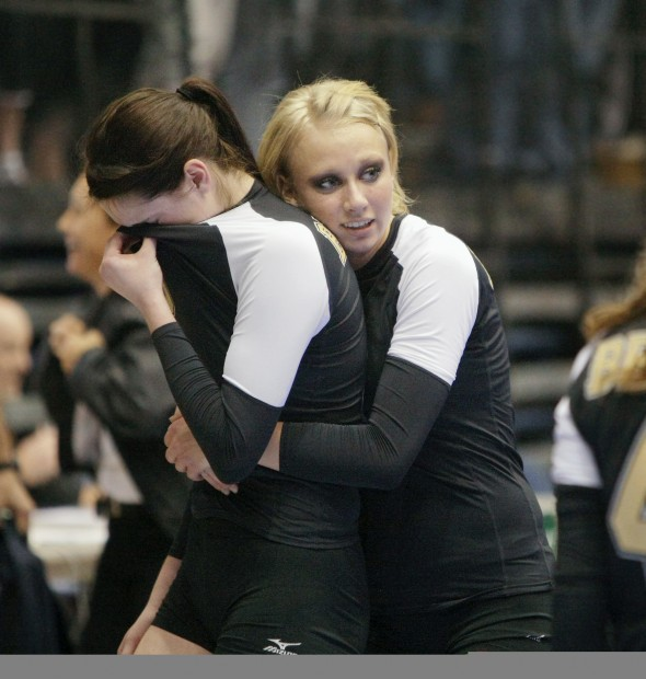 Cherina Walen of Billings West hugs Kylie Nielsen after the Bears lost the Class AA title game