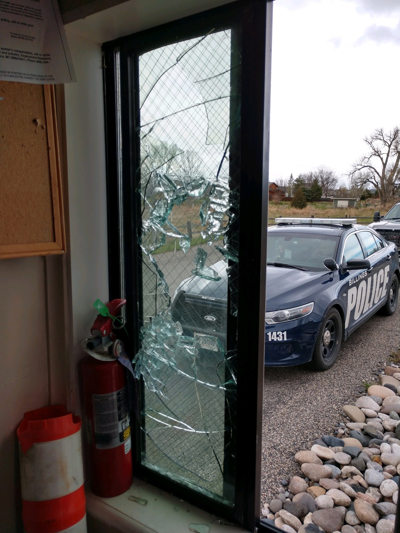 Broken entrance building window