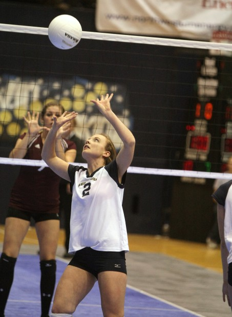 Anna Brajcich of Red Lodge sets a ball