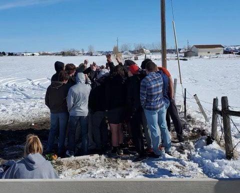 Crash memorial huddle