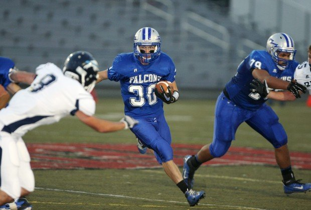 Drake Schafer of Skyview carries the ball