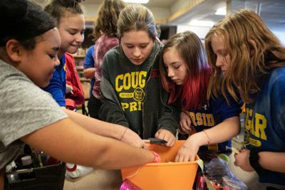 ReACT students paint pumpkins